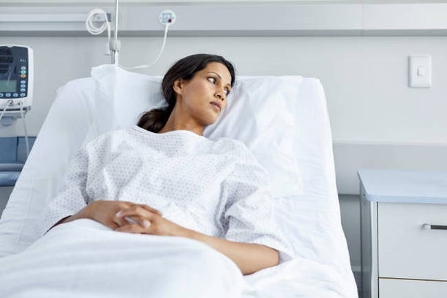 woman-hospital-bed
