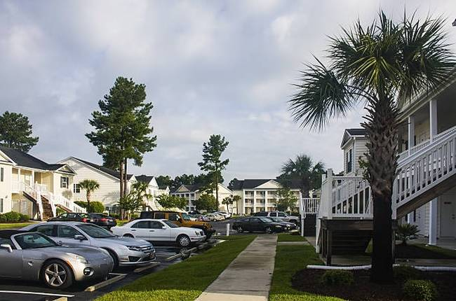 parking-lot-cars-houses